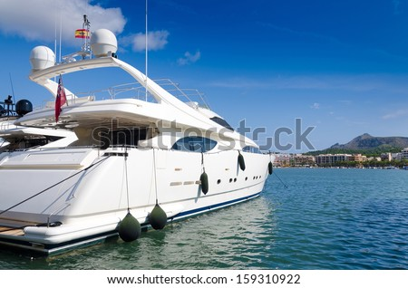 Luxury boat in tropical marina