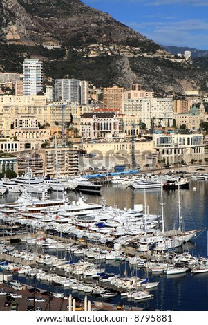 Luxury boats docked at the waterfront of Monte Carlo in Monaco. - stock photo