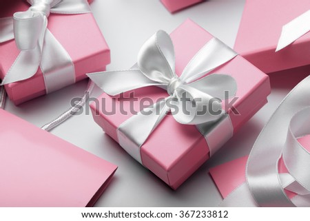 Luxury boxes tied with a white ribbon. - stock photo