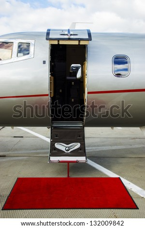 Luxury Business Private Jet plane open door at airfield