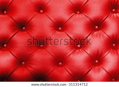 Luxury Button Red Leather for Background Uses. - stock photo