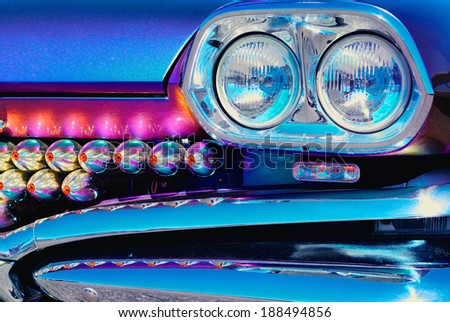 Luxury car front bumper and lights detail - stock photo