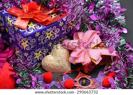 luxury Christmas gifts box wrap with a pink ribbon and a bow. Christ born on December snow celebrate India Kerala
