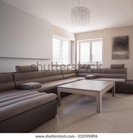 Luxury comfortable corner sofa in exclusive residence - stock photo