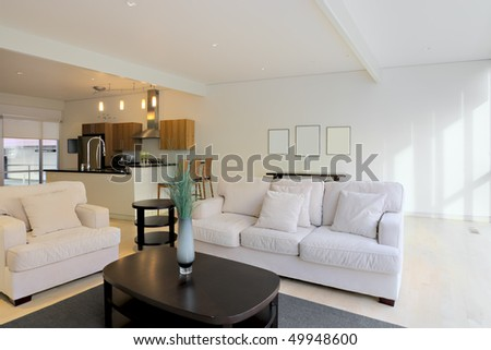 Luxury Condominium Apartment Living Space with view to Kitchen area - stock photo