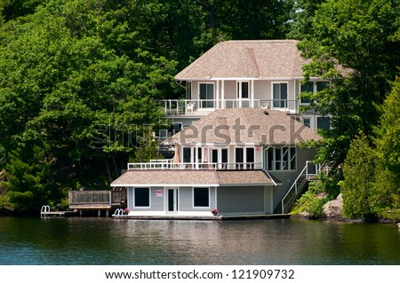 Luxury Cottage with a boathouse - stock photo
