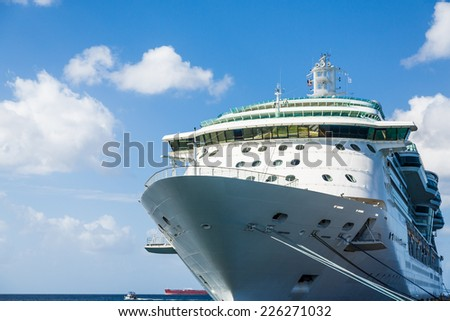 Luxury Cruise Ship Anchored Under Nice Skies at Harbor on St Croix - stock photo