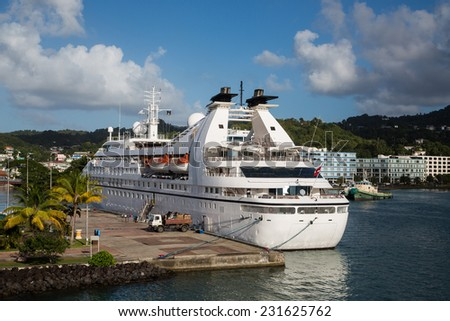 Luxury cruise ship docked in harbor of St Lucia in the Caribbean - stock photo