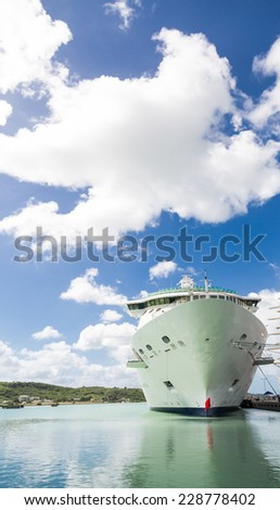 Luxury Cruise ship in a harbor by a four masted schooner - stock photo