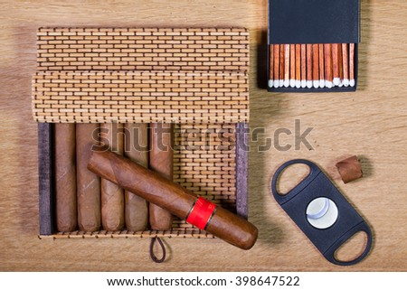 Luxury Cuban cigars on the wooden table - stock photo