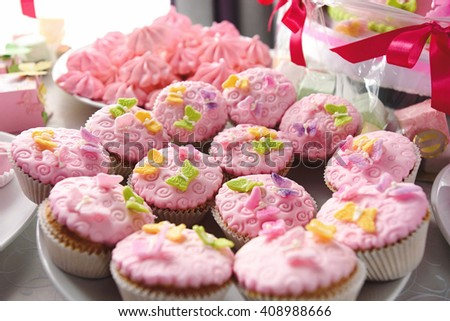 luxury delicious pink cupcakes and candy bar at celebration, party in a restaurant - stock photo