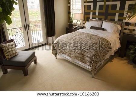 Luxury designer bedroom with large windows. - stock photo