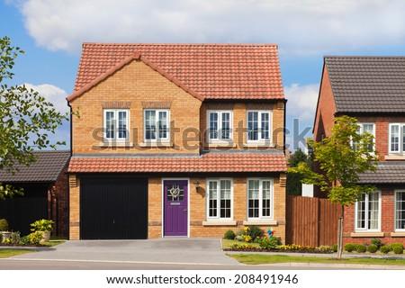 Luxury detached house with purple door - stock photo