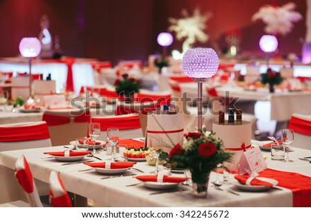 Luxury expensive catering and wedding reception decorations tables with roses - stock photo