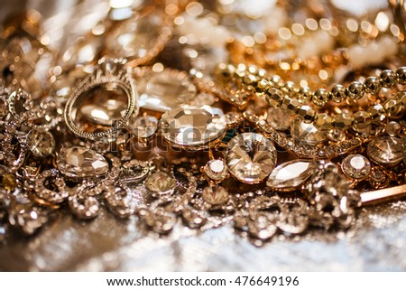 Luxury fashion background of close up of golden jewelry