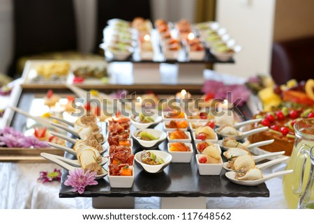 Luxury food and drinks on wedding table. Shallow DOF - stock photo
