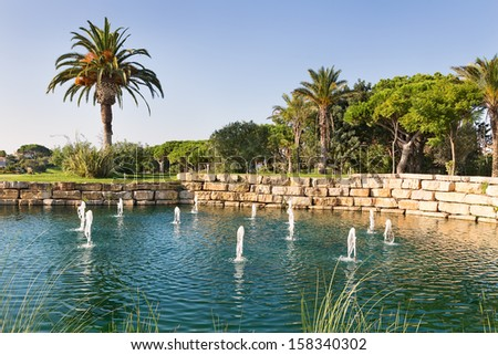 Luxury Fountain Lake in the park golf course in Portugal. - stock photo