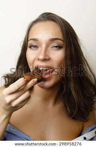 luxury funny beautiful young lady with seductive lips  eating candy on  happy smiling and looking at camera closeup portrait.