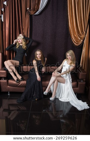 luxury girls in evening dresses in beautiful settings - stock photo