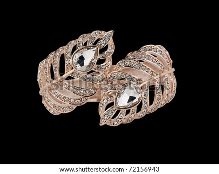 Luxury gold bracelet with diamonds - stock photo