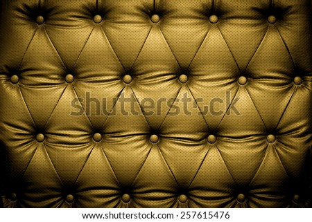 Luxury gold leather texture background with buttoned pattern - stock photo