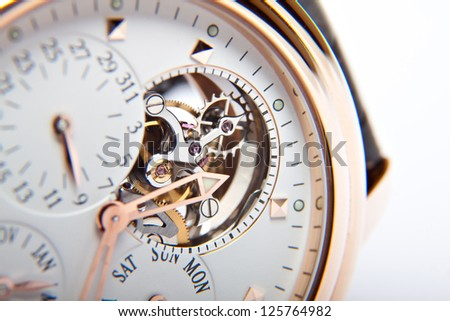 luxury gold watch swiss made - stock photo