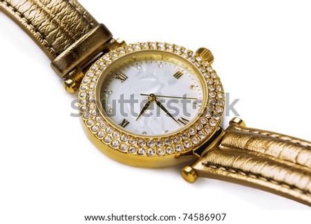 Luxury gold wristwatch with gems isolated on white - stock photo
