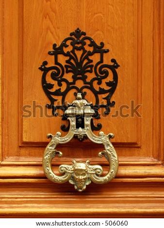luxury golden doorknocker - stock photo