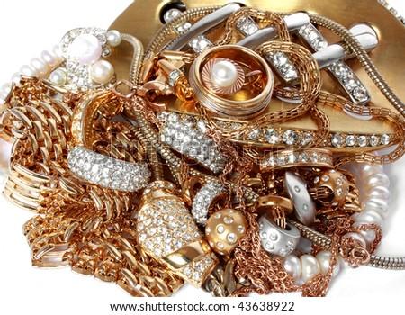luxury golden jewelry with precious stones - stock photo