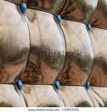 Luxury golden leather close-up background - stock photo