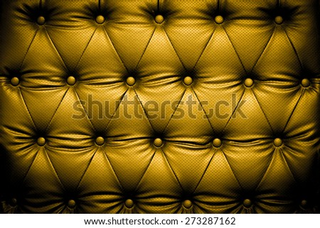 Luxury golden leather texture with buttoned pattern - stock photo