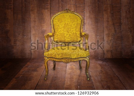 Luxury Golden sofa in the background of the wood.