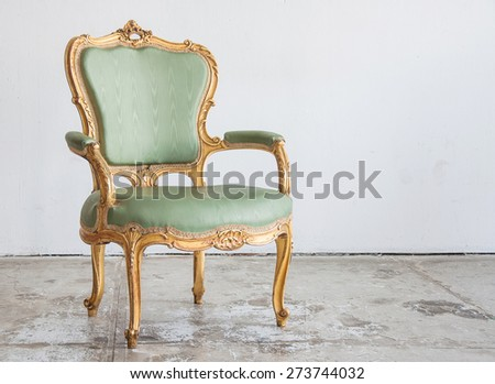 Luxury green vintage style armchair  in a vintage room