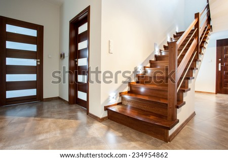 Luxury hallway with wooden stairs to bedroom on the floor - stock photo