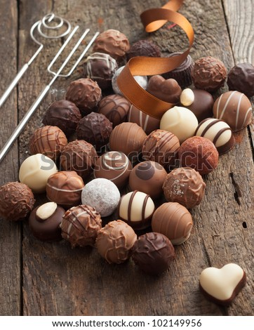 Luxury handmade chocolate bonbon assortment of delicious decorative round chocolates with a festive ribbon for a celebration - stock photo