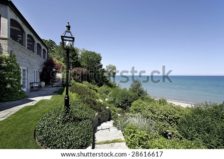 Luxury home and view of lake - stock photo