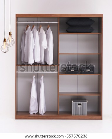 Luxury home bedroom, wardrobe, shirts and modern interior design lamp