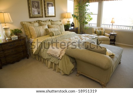 Luxury home bedroom with stylish furniture and decor. - stock photo