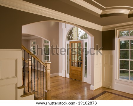 Luxury Home Entrance way with Staircase - stock photo