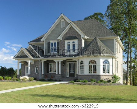 Luxury Home Exterior against blue sky - stock photo