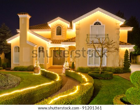 Luxury home exterior in the night time with the christmass lights - stock photo