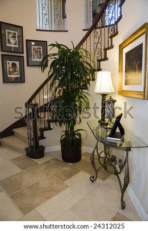 Luxury home hallway with a tiled floor. - stock photo