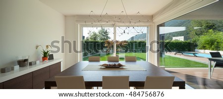 Luxury home interior, comfortable dining room, modern furniture
