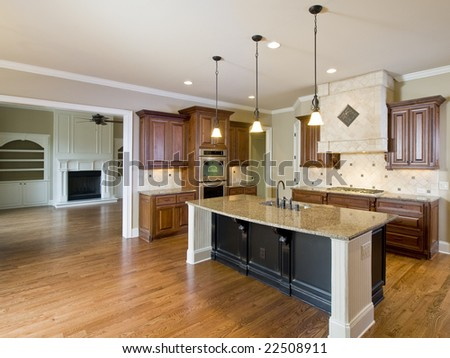 Luxury Home Interior Kitchen and Living Room with fireplace - stock photo