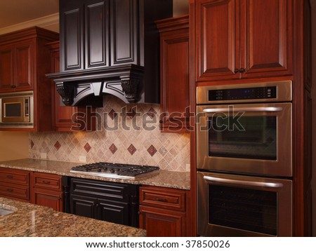 Luxury Home kitchen two tone wood cabinets - stock photo