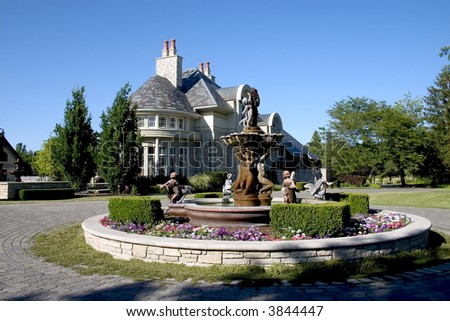 Luxury home with Fountain - stock photo