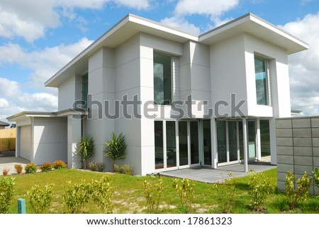 luxury home with landscaped backyard - stock photo