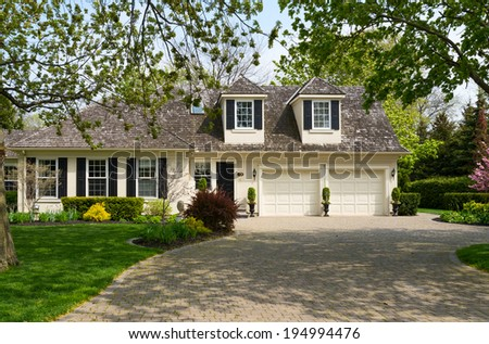 Luxury home with nice landscaping - stock photo