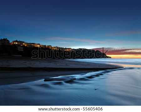 Luxury homes overlook the California coast at sunset - stock photo