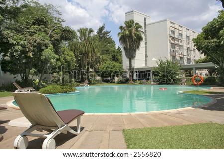Luxury hotel and pool - stock photo